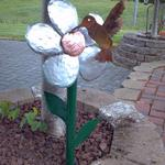 Stainless flower with burnt copper hummingbird
